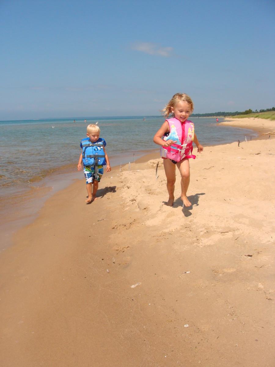 Running along the beach on Lake Michigan.