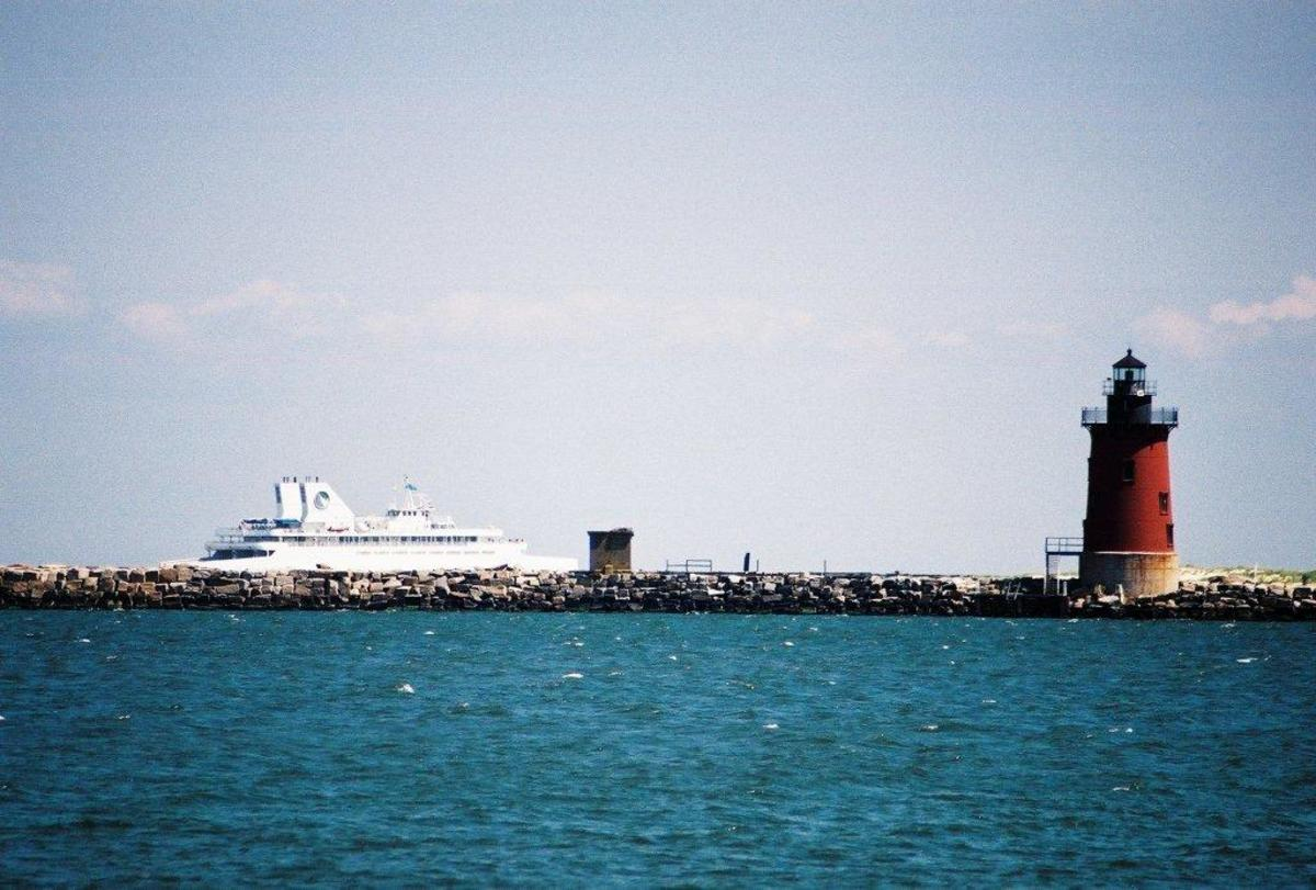 View of the ferry boat and Delaware Breakwater East End Lighthouse as seen from the Cape Henlopen Fishing Pier.