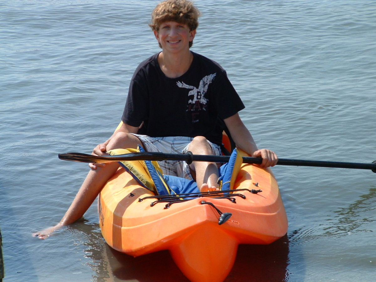 My great nephew, Brett,  likes to kayak.. He was coming back in here, and shoes and vest were removed.