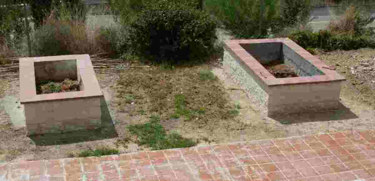 the two ornamental raised beds I had built shortly after completion. The one on the right is bigger than the one on the left.