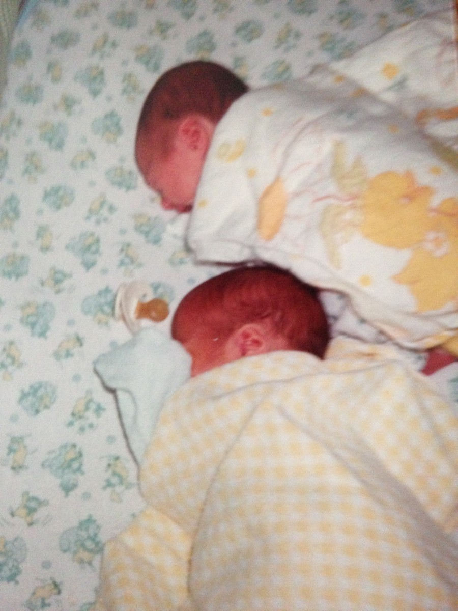 Elizabeth on top Michael on bottom. This was their favorite sleeping arrangement for months. Notice Mike has Pacy. Elizabeth soon learned to suck her thumb like her Mommy!!!