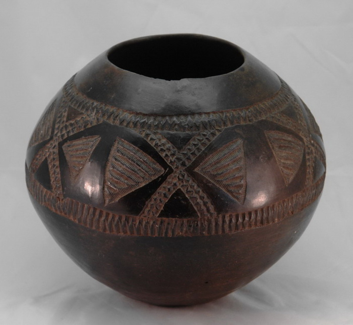 "Zulu gourd used to drink traditional beer and mostly used during the ""Amadlozi"" (Ancestors) celebration or customary rites(called ""Ukhamba"")"