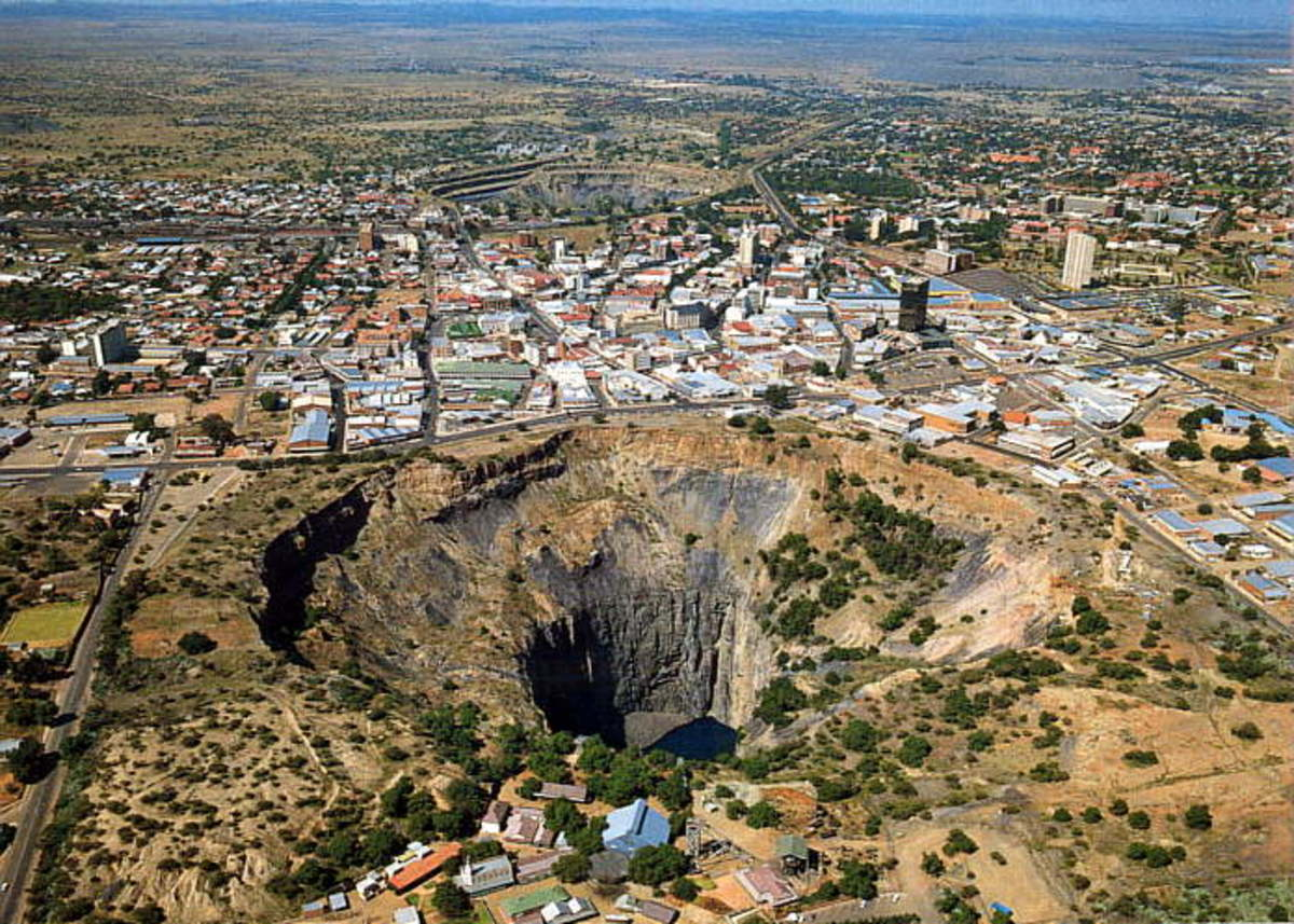 "Aerial view of Kimberley, the type of locality of Kimberlite - the primary source of diamonds. Kimberley Mine open Pt (""Big Hole"") in the foreground, and De Beers mine open pit in the background"
