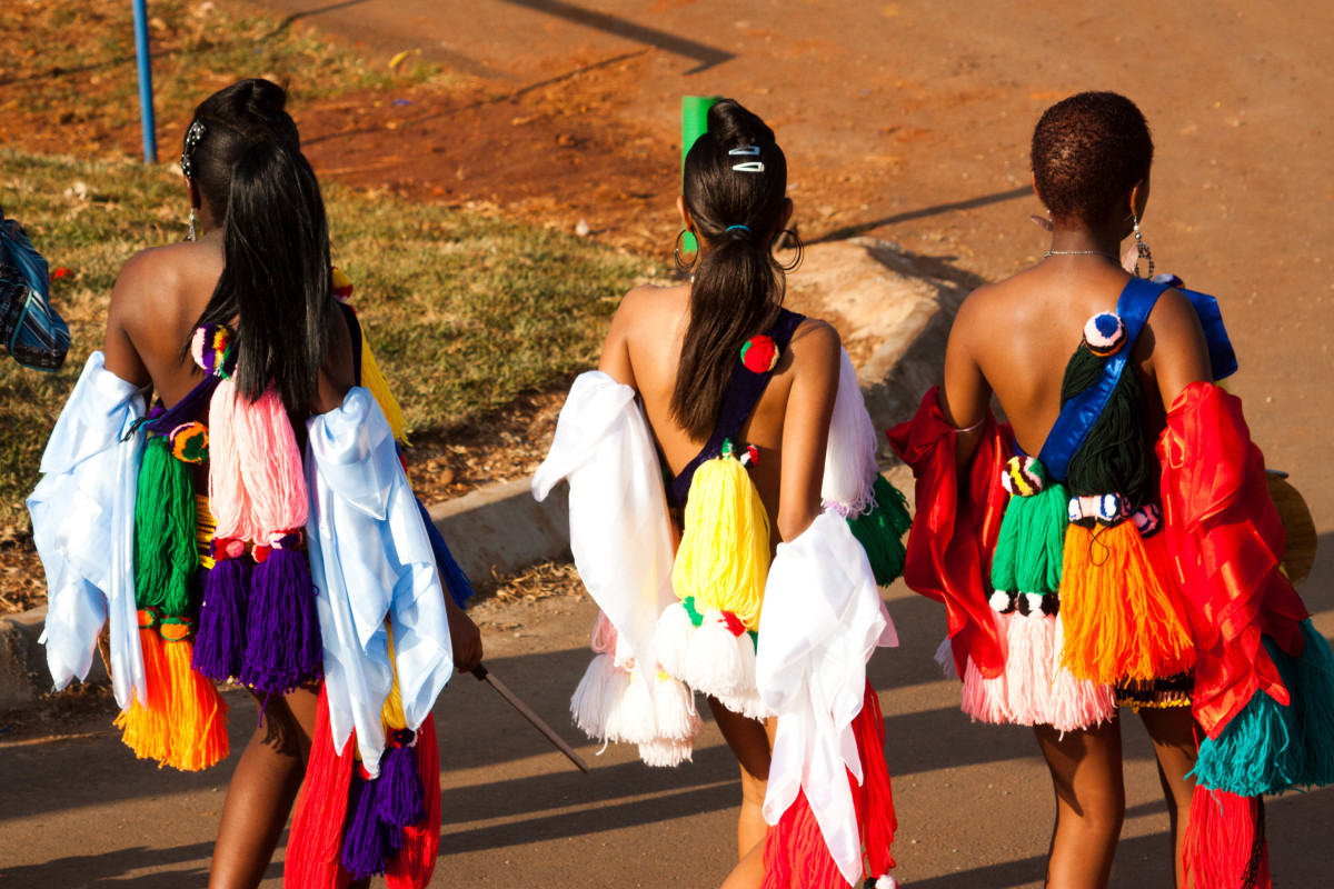 Swazi girls in bright traditional colors and cress