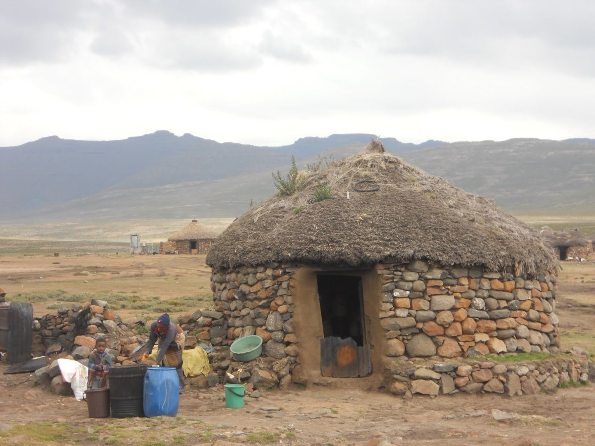 Basotho people's hut made of stones with thatched grass serving as a roof