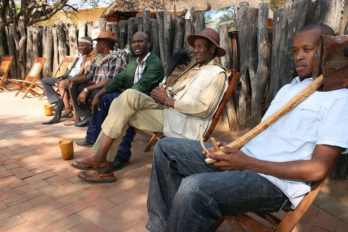 Tswana men and their musial instruments and ensnemble