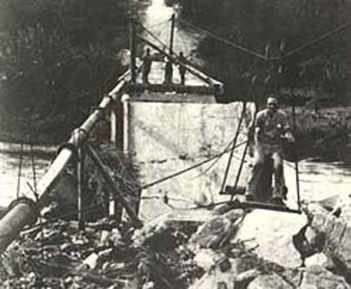 At a later stage of the operation a slightly more sophisticated type of bosun's chair takes Mr. Karel Kolkenbeck-Ruh across when the Selati River is in full flood