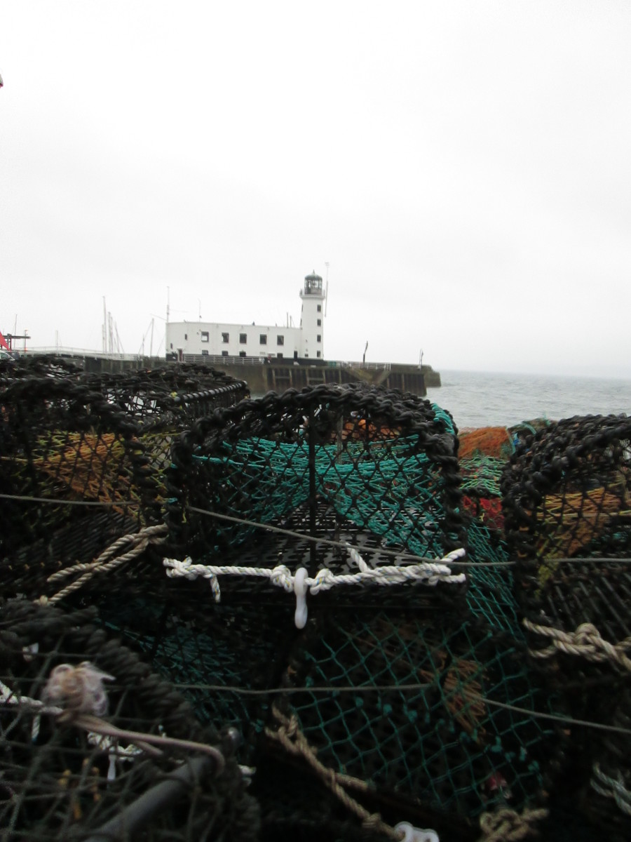 A view of the lighthouse from across some of the crab and lobster traps on the Fish Quay