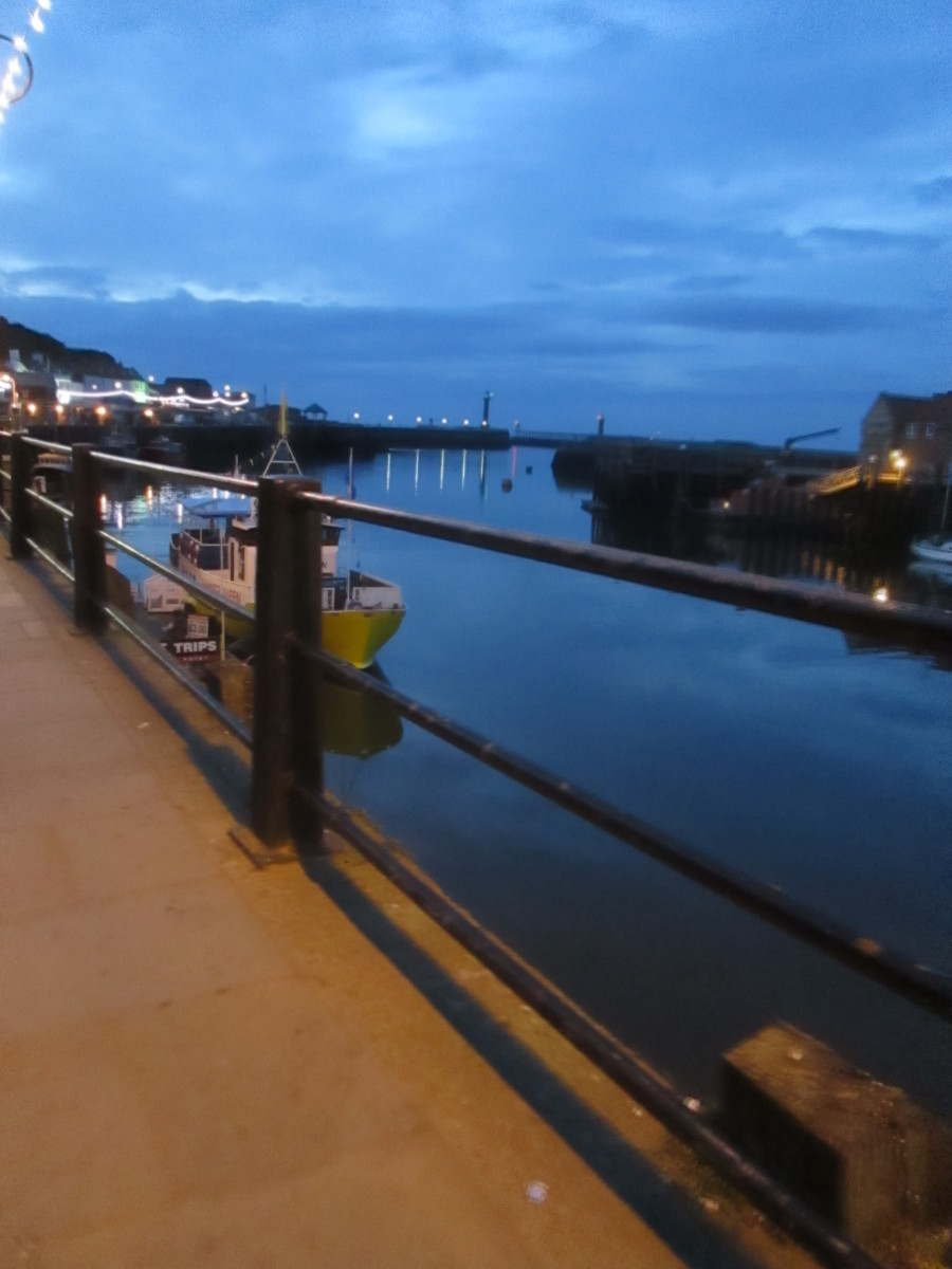Looking out along quay to the harbour mouth in the evening, mid-May, 2016