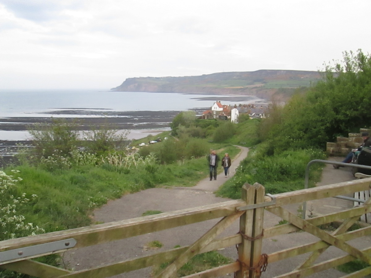 Park at the old station site, walk down past more recent hotels and housing. A new wall was built in the 70s to shore up the cliff that the 'road' to the left descended. It's a footpath now, that leaves the course of a road that leads nowhere.