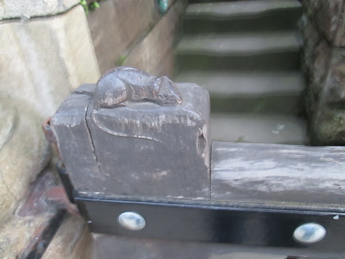 One of Robert Thompson's mice guards the gate at the erstwhile police station