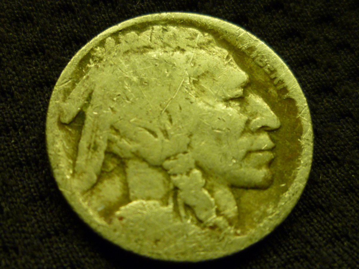 Date-less Nickel. This could have been a Key Date, but excessive wear has left this Nickel virtually worthless.