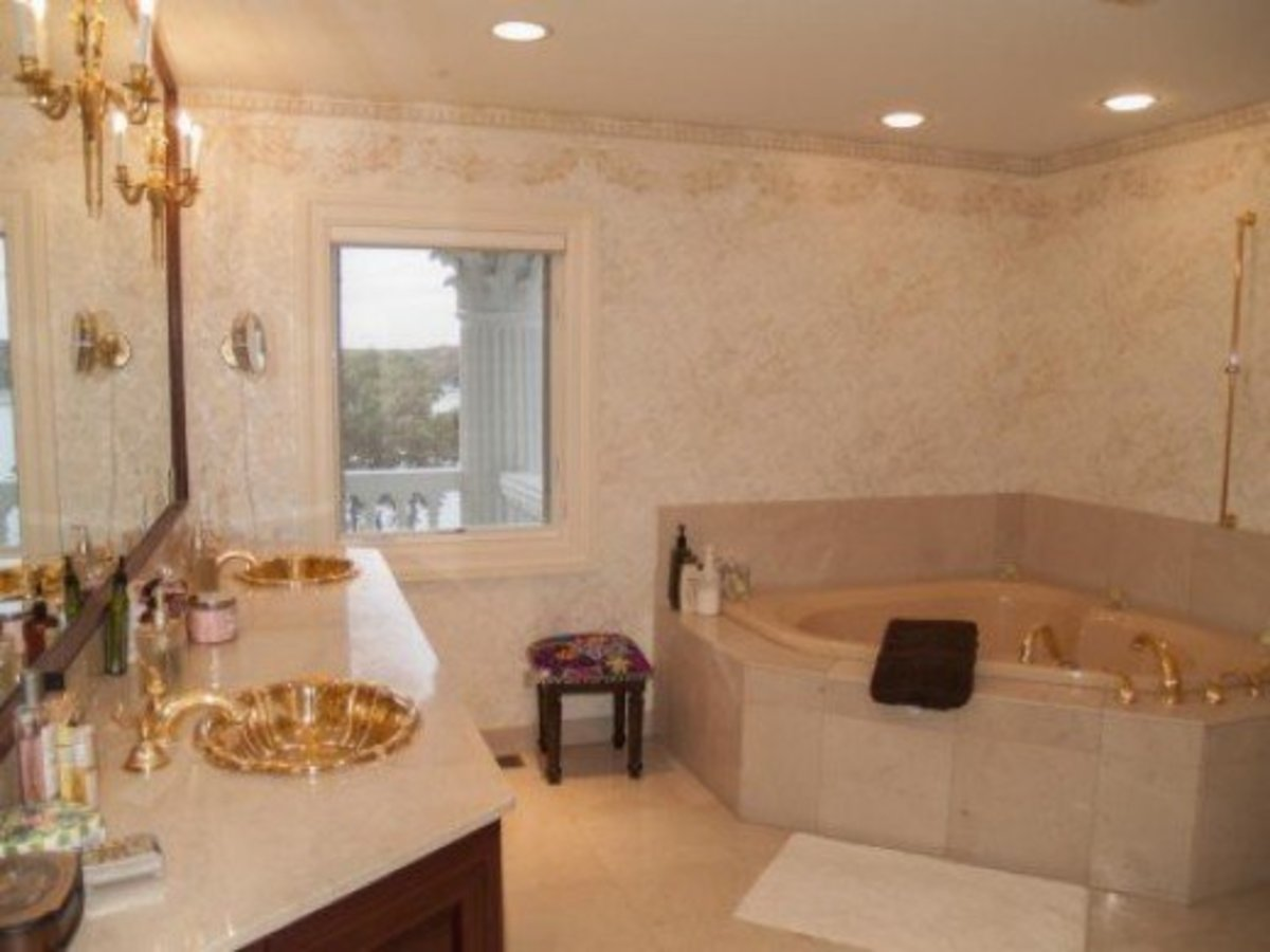 Twin Gold Sinks in Luxury Bathroom with Marble Countertops