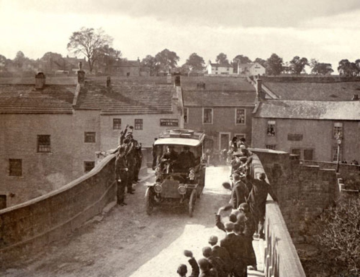 Pre-WWI view of a car entering Barnard Castle over the County Bridge (former boundary with the North Riding until 1974) from the village of Startforth - see comments box below