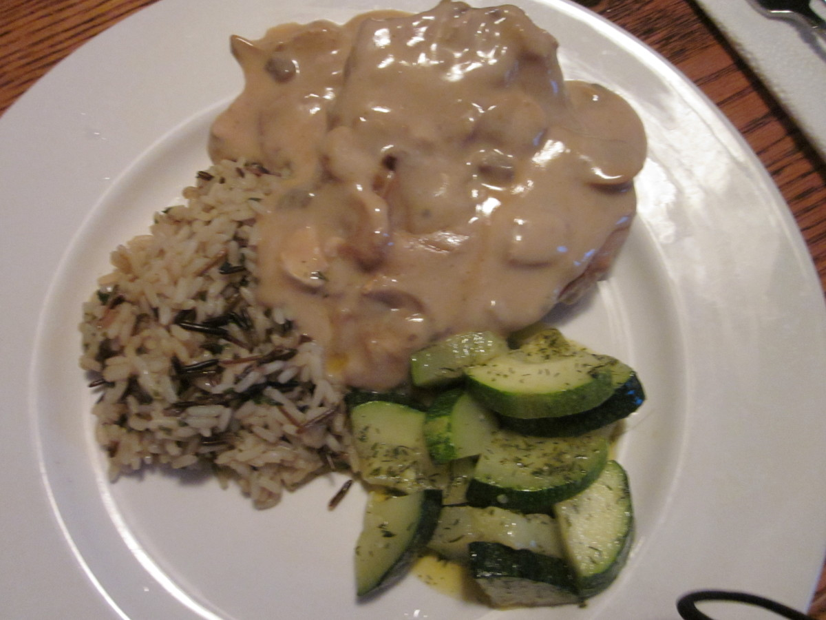 Pork Chops with Mushroom Gravy, Wild Rice and Zuchinni