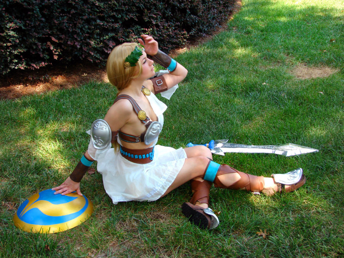 Sophitia sitting on the grass.