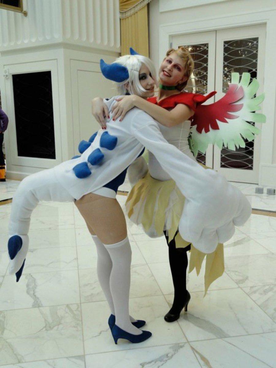 Lugia and Ho-Ho giving each other a hug.