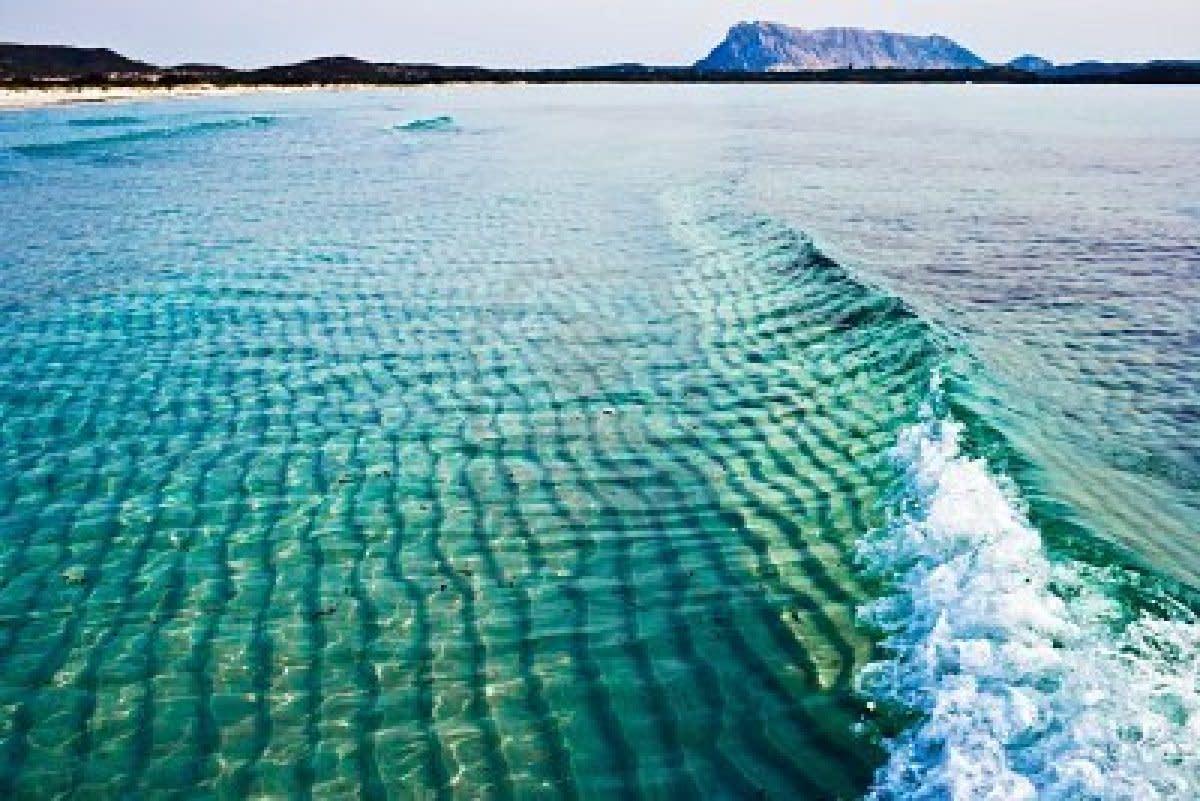 Green and Blue Tyrrhenian Sea near la Cinta beach, Sardinia, Italy