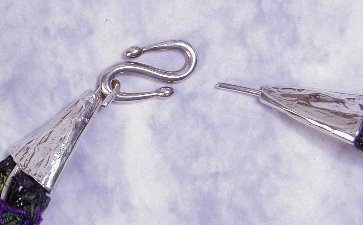 The two silver flat cones are examples of a standard end cap