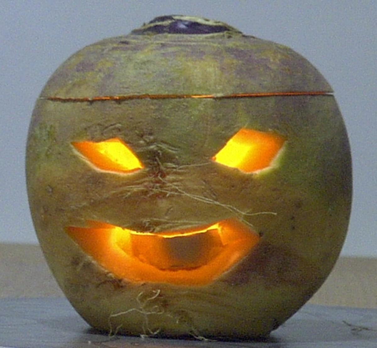 A carved turnip jack-o-lantern