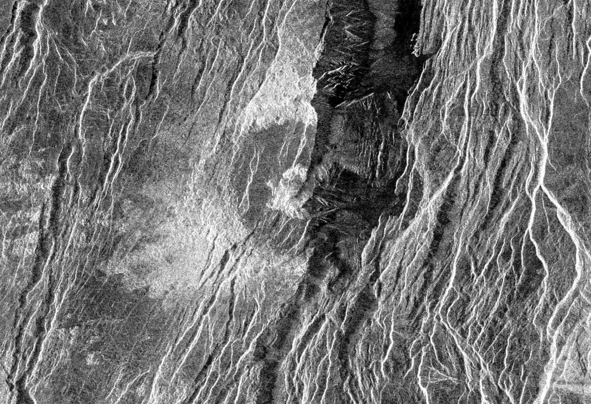 The fractured Somerville Crater on Beta Regio. Disruption of the crater by this fracturing can only have occurred subsequent to the meteor impact, and must therefore be more recent than any global resurfacing event