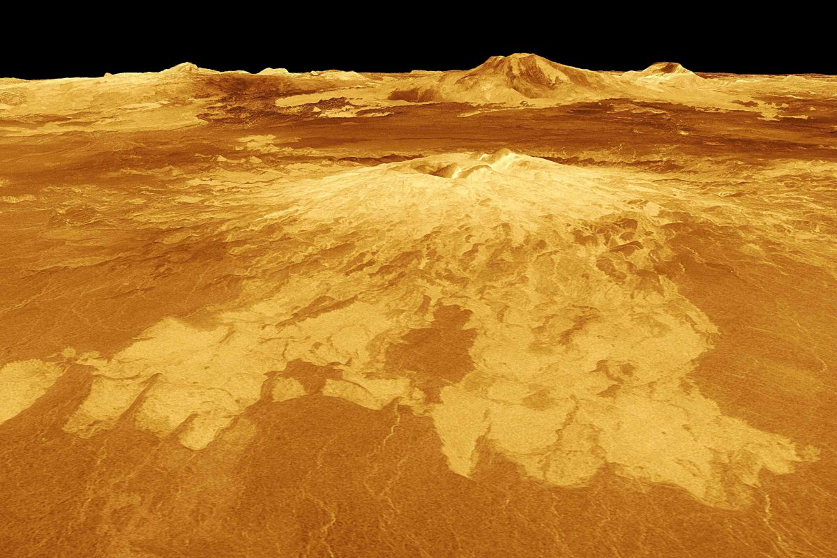 Sapas Mons rises 4 km above the surrounding plains of Atla Regio. Lava flows extend for hundreds of kilometers across the fractured plains shown in the foreground to the base of Sapas Mons. At least five volcanoes are known in this region