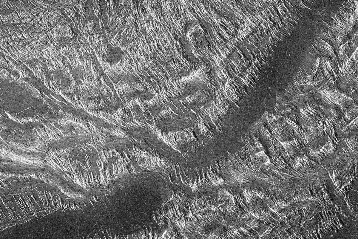 Ovda Regio is one of the highland regions, characterised by lava channels (the dark area across the centre) and numerous ridges and valleys - there can be no better evidence of considerable deformation of the surface in the past