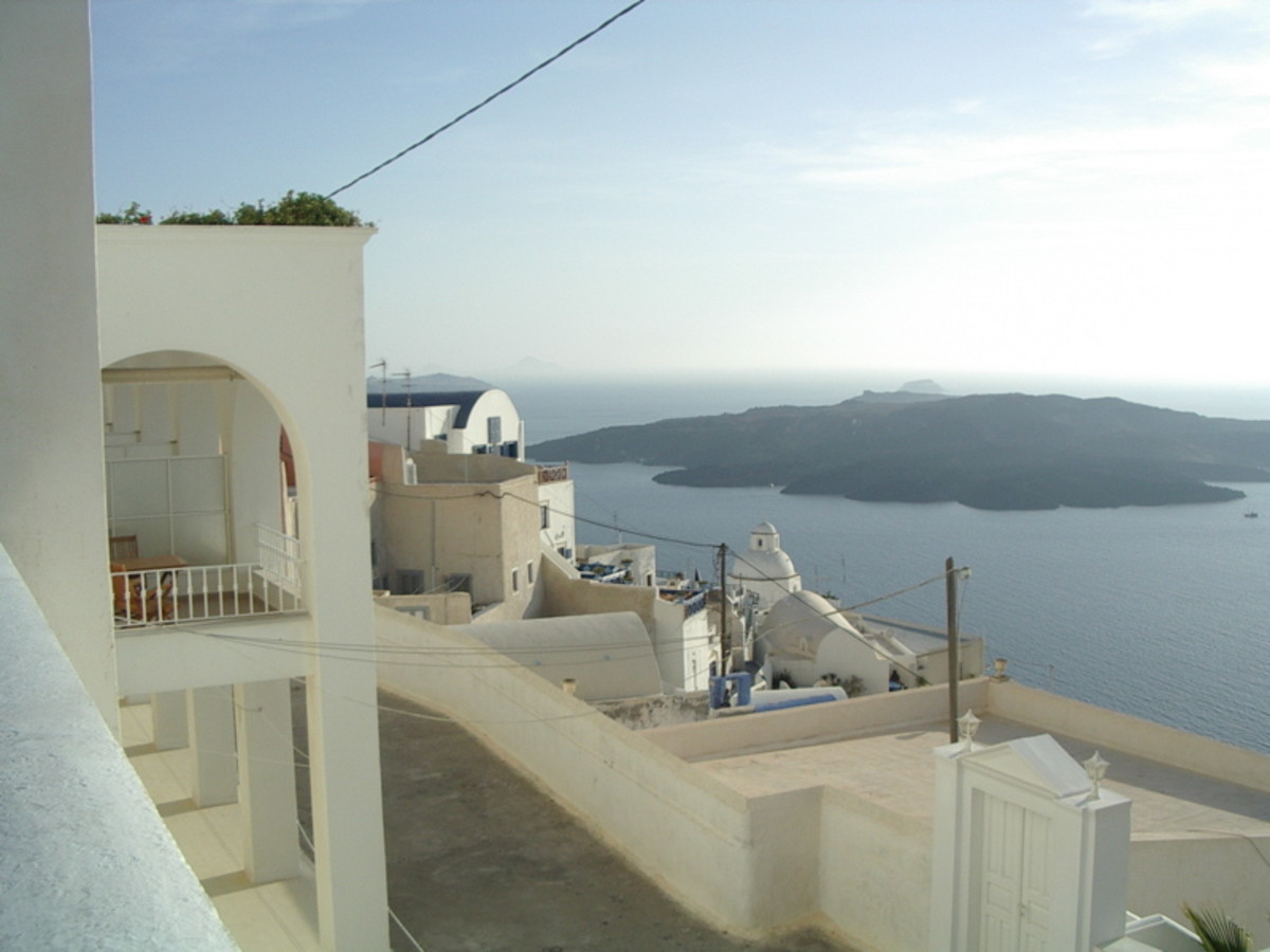 My photo from the cliff-tops of Thera, the largest island in Santorini's ring of islands which are all that's left of a larger island destroyed in 1600 BC. In the middle of the ring is Nea Kameni, the growing volcano that first appeared in 197 BC.