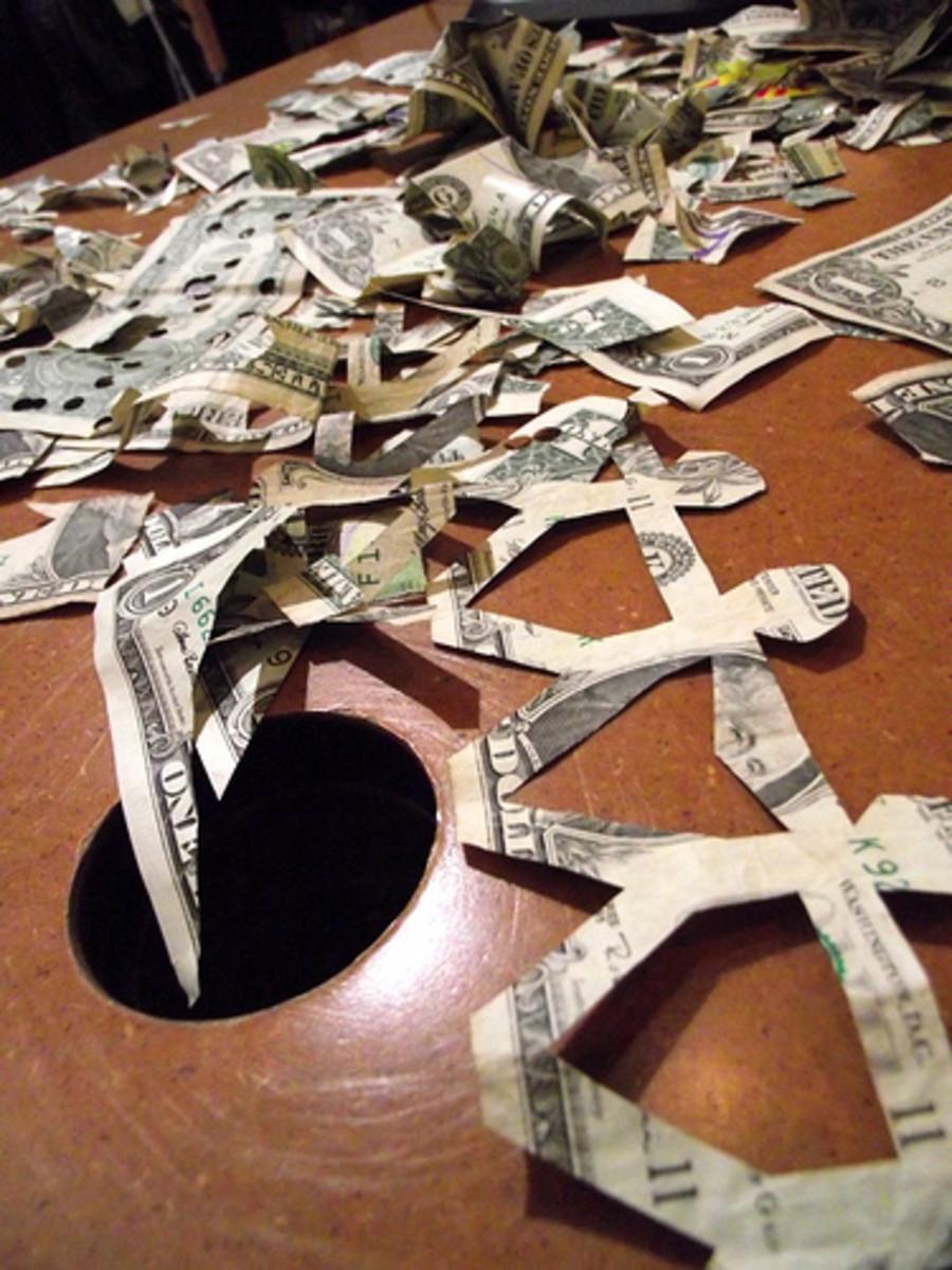 Tearing Money by Alejandro Tamayo