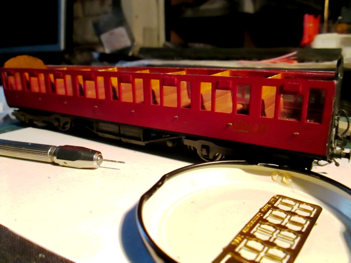 Work underway on a Thompson 8 compartment non-corridor coach - Comet 'tumblehome' sides with Ian Kirk plastic seating and painted compartment walls. Underframe and door-handle detailing from MJT - awaiting grab rails at door sides.