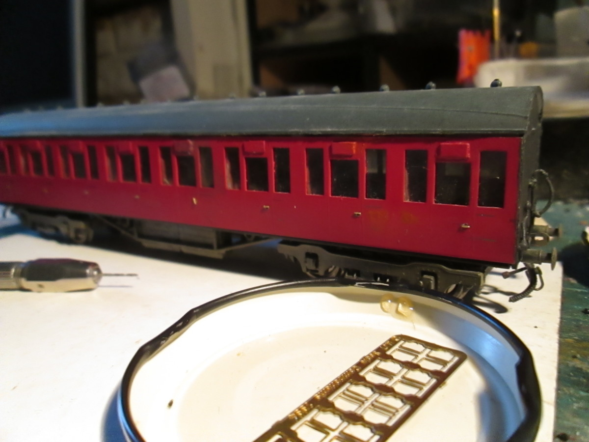 The roof has been temporarily set in place to show the appearance - MJT LNER-type torpedo vents fixed in place before re-numbering (MJT door handle and grab rail etched fret in foreground)