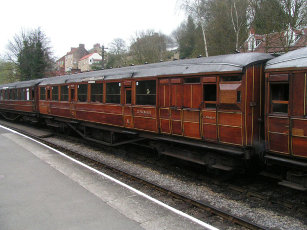 Rake of Gresley side-corridor stock in teak with gold sized lettering and numbering on Severn Valley Railway (SVR)