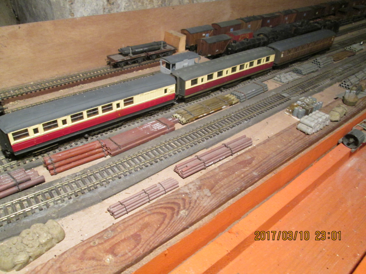 Three 1980s Hornby Gresley 61 foot side corridor stock (compartments had doors to the outside as well as to the corridor). Modified with brass and white metal underframe detailing