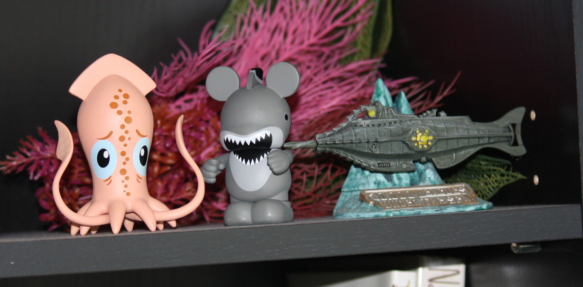 The Park Starz giant squid hanging out with a shark Vinylmation Mickey and a very small Nautilus from Tokyo. (The fake seaweed behind them is salvage from the old 20,000 Leagues ride, or so I'm told.)
