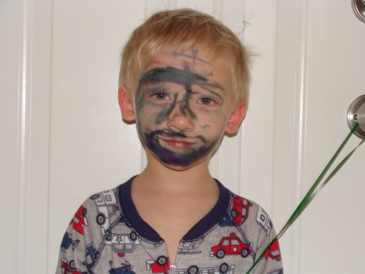 "Alex colored his face with black marker so he would have a mask like ""the bad guys!"""