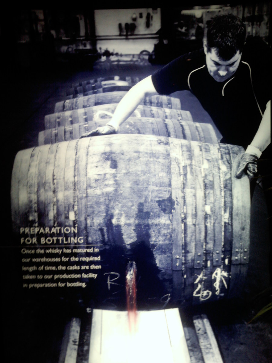 Barrels are unplugged and the contents are poured out into whisky stills