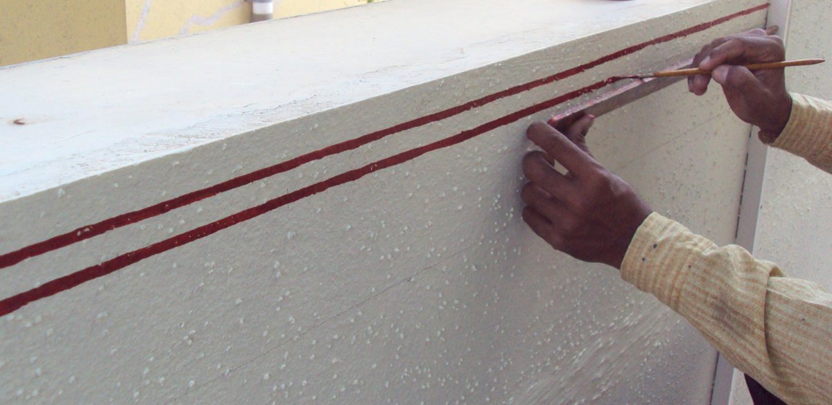 Artist painting the double lined border