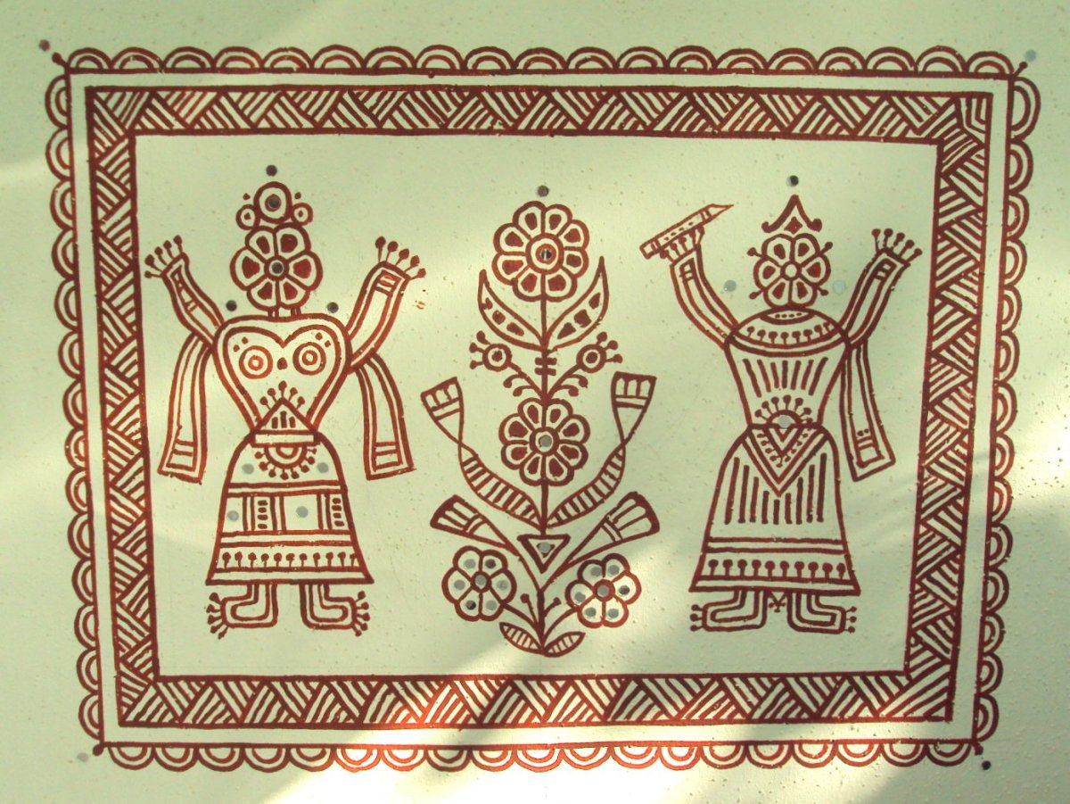 Sunlight streaming on a beautiful Bheenth Chitra, tribal wall art centrepiece motif