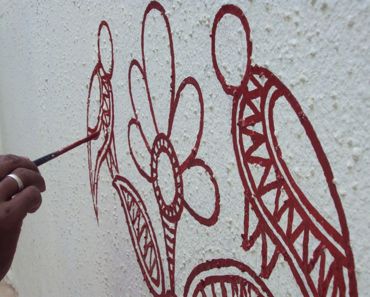 The artist working on the first motif