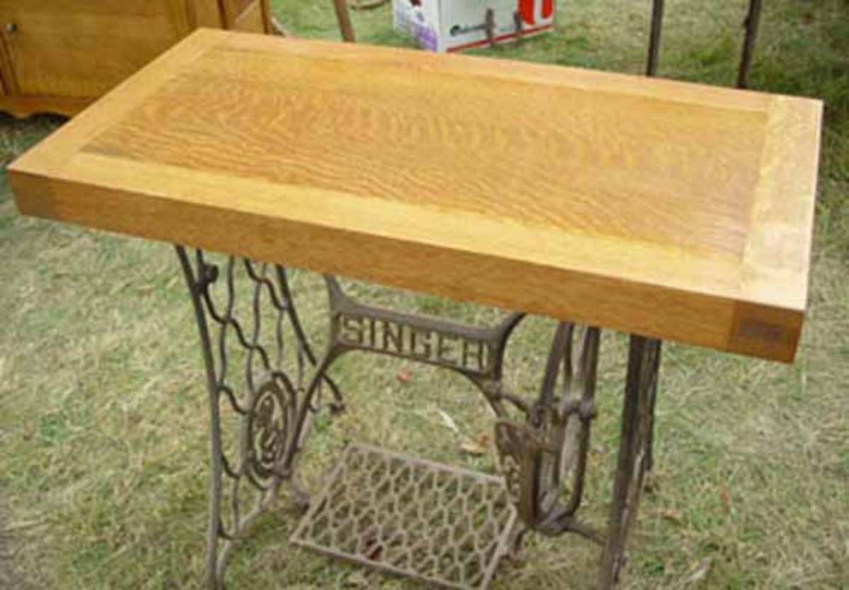 Upcycled antique table made from sewing machine and piano parts
