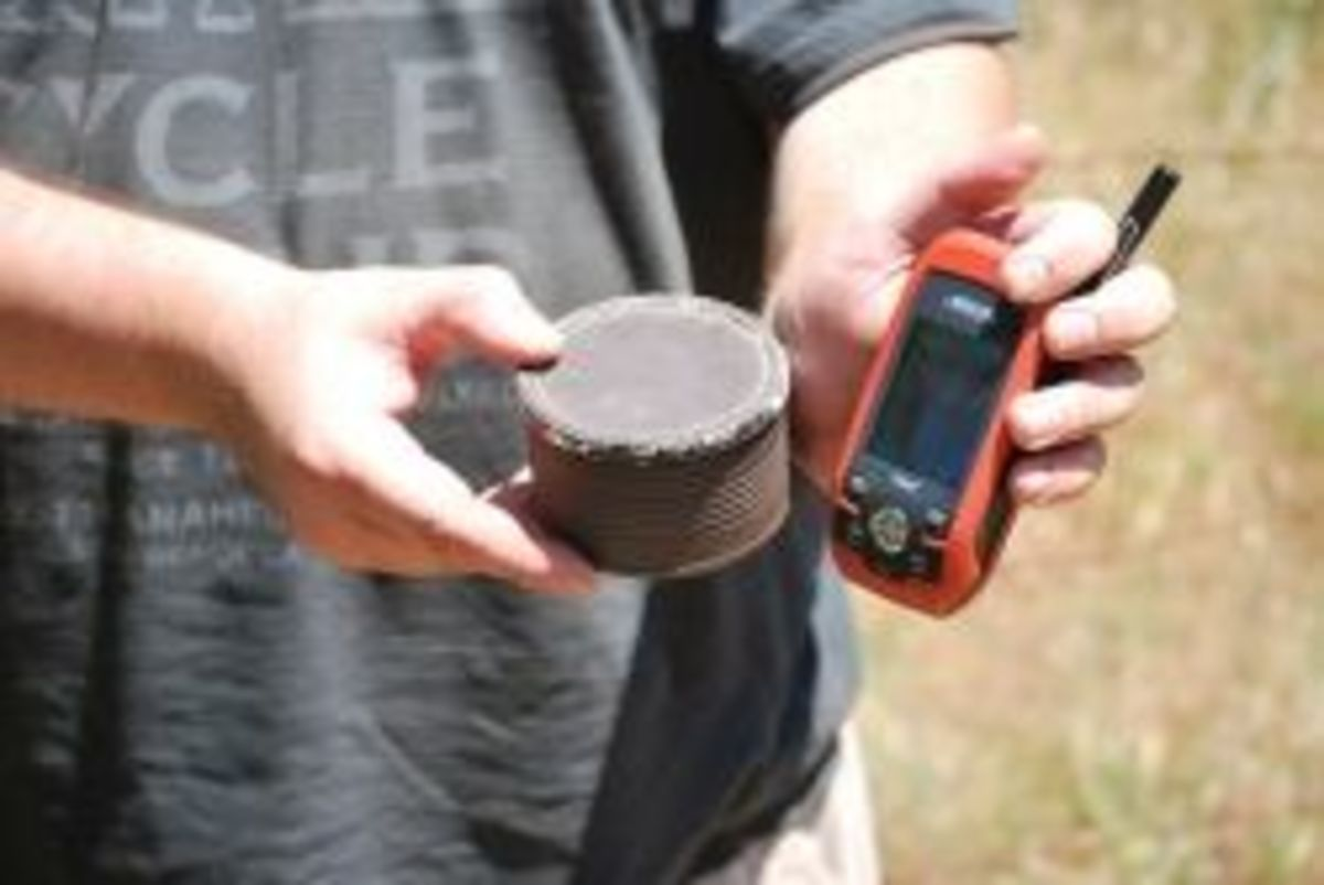 Geocacher with GPS and cache