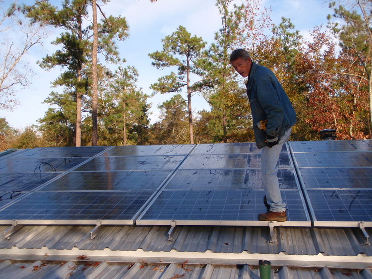 Rooftop solar panels in the process of installation
