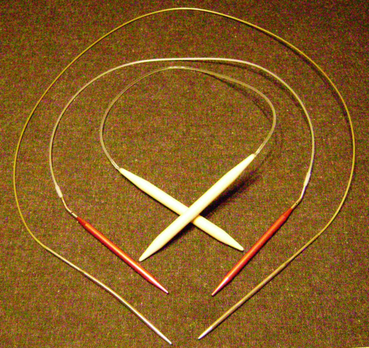 Circular needles help prevent dropped stitches and are used for working in the round and for larger knitted pieces.