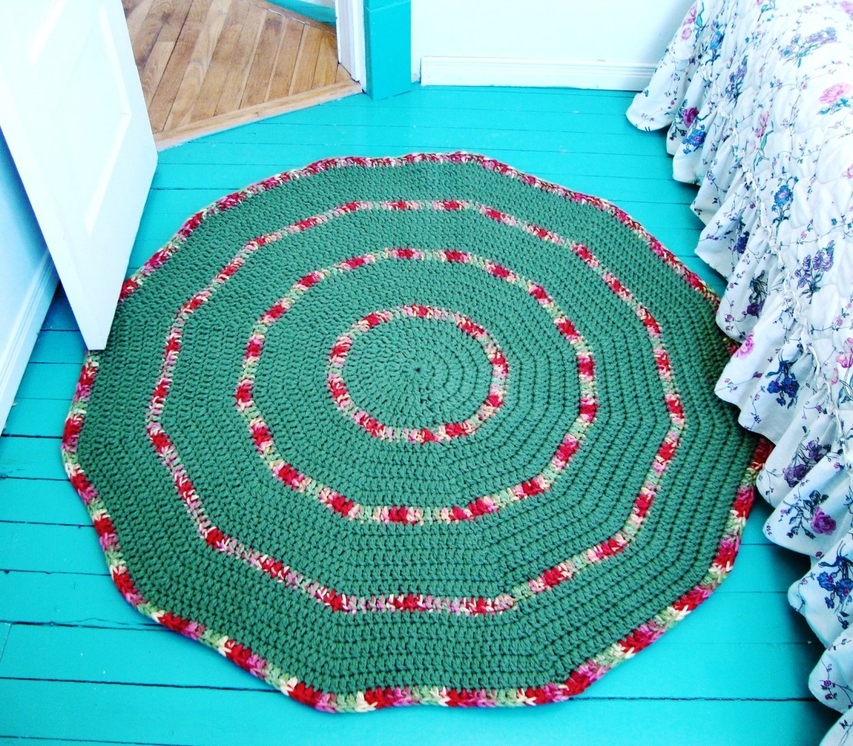 A bulky yarn is used to make a crocheted rug.