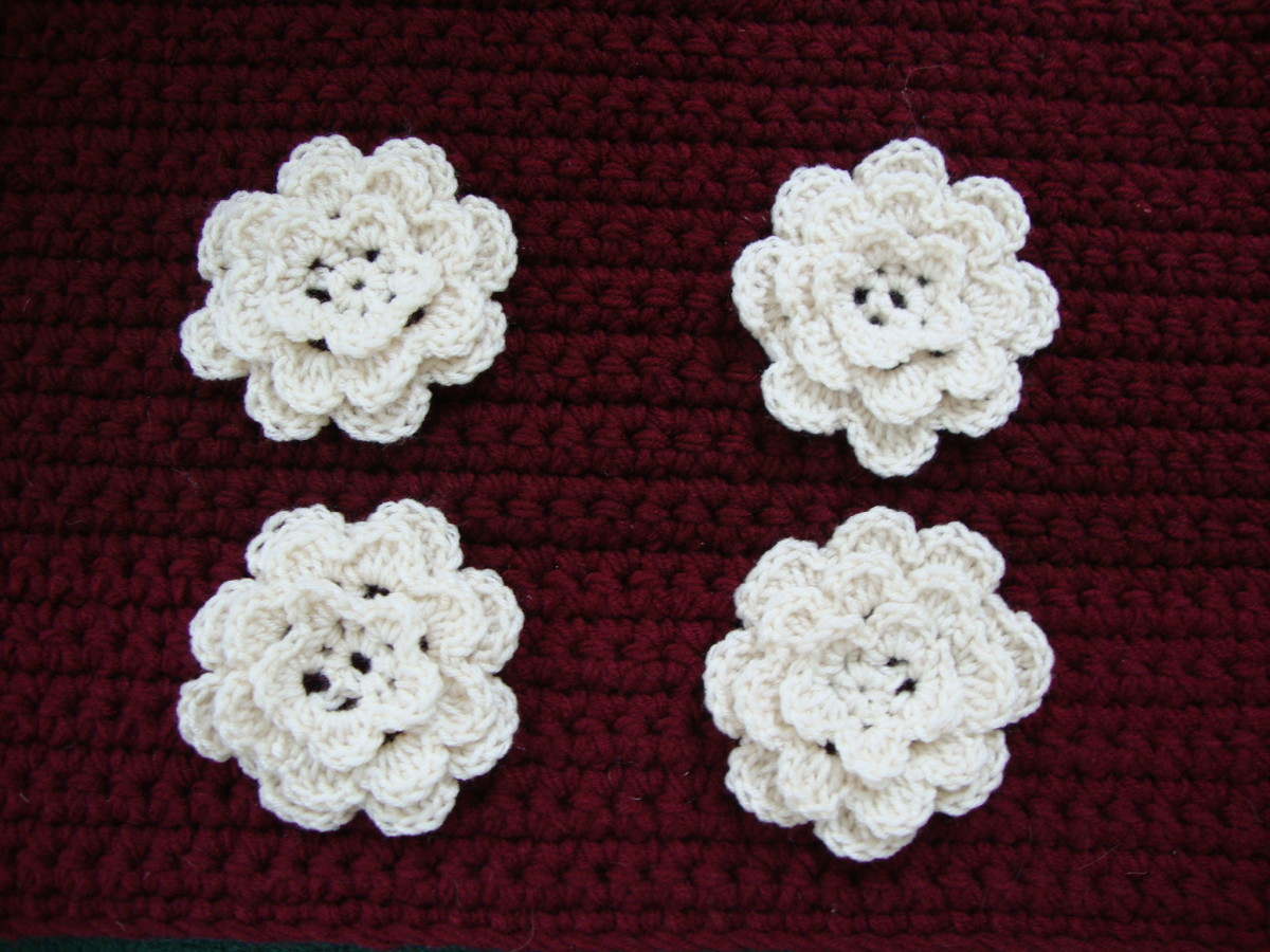 Crocheted flowers are used to adorn hats and other handmade items.