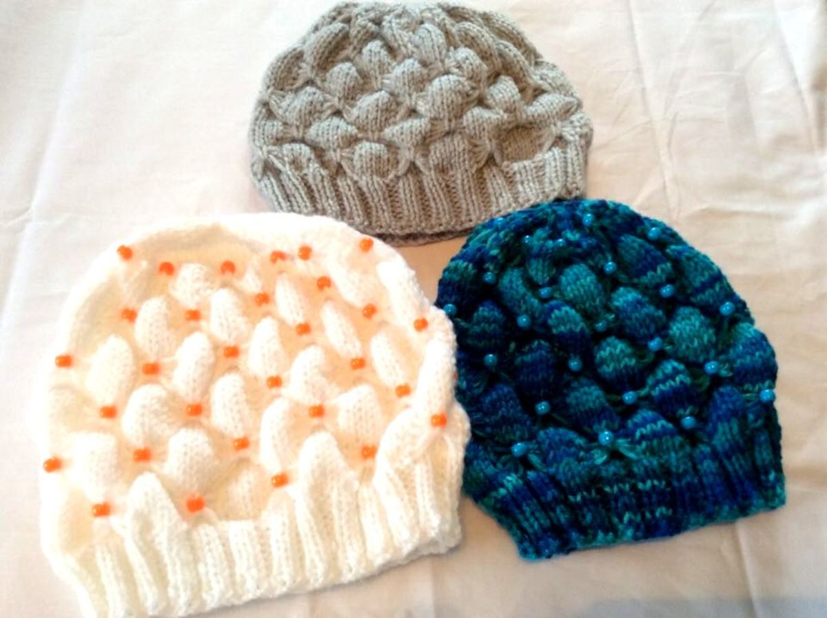 These pretty knitted hats include colored beads.