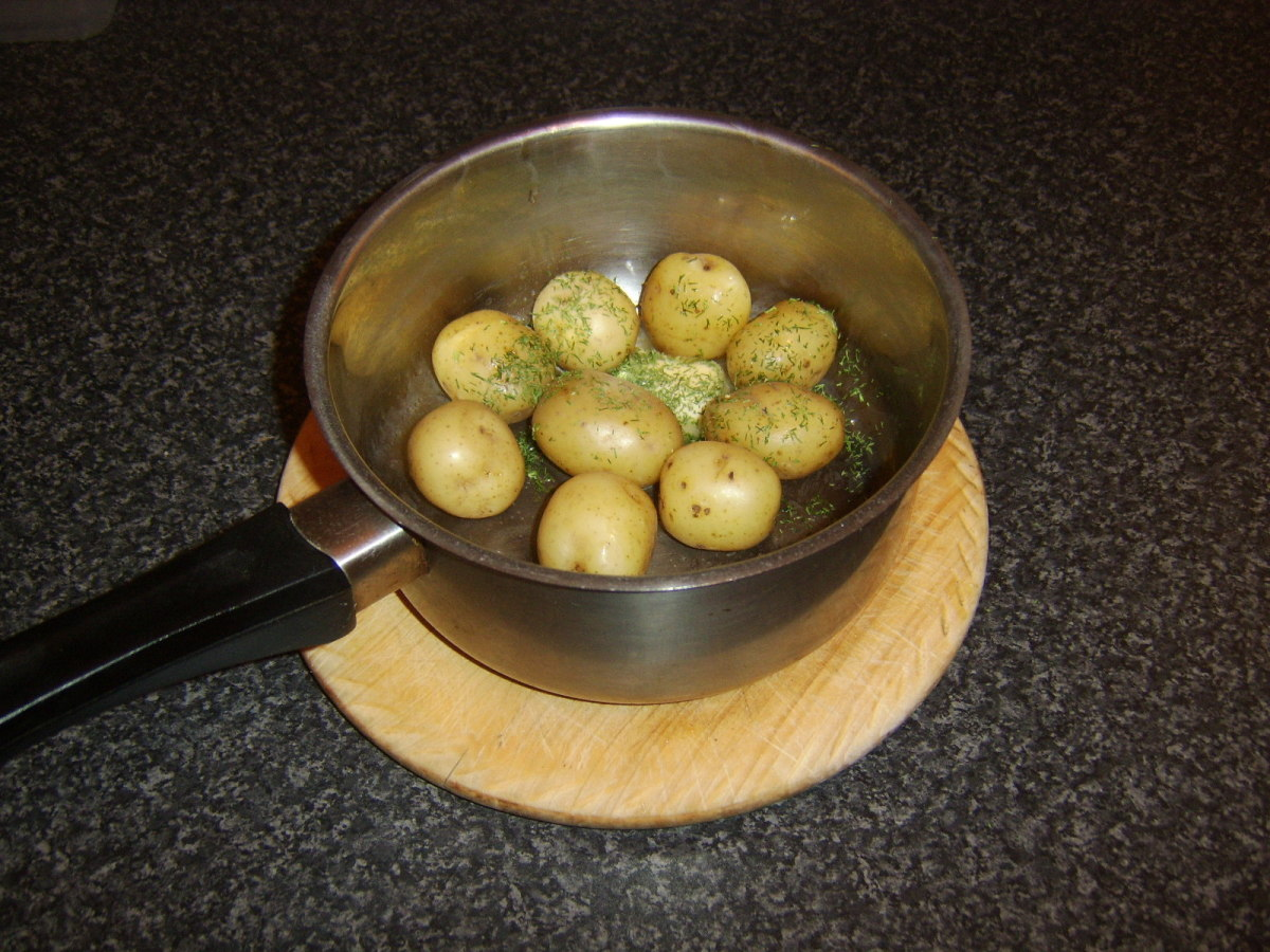 Butter and dill are added to the new potatoes