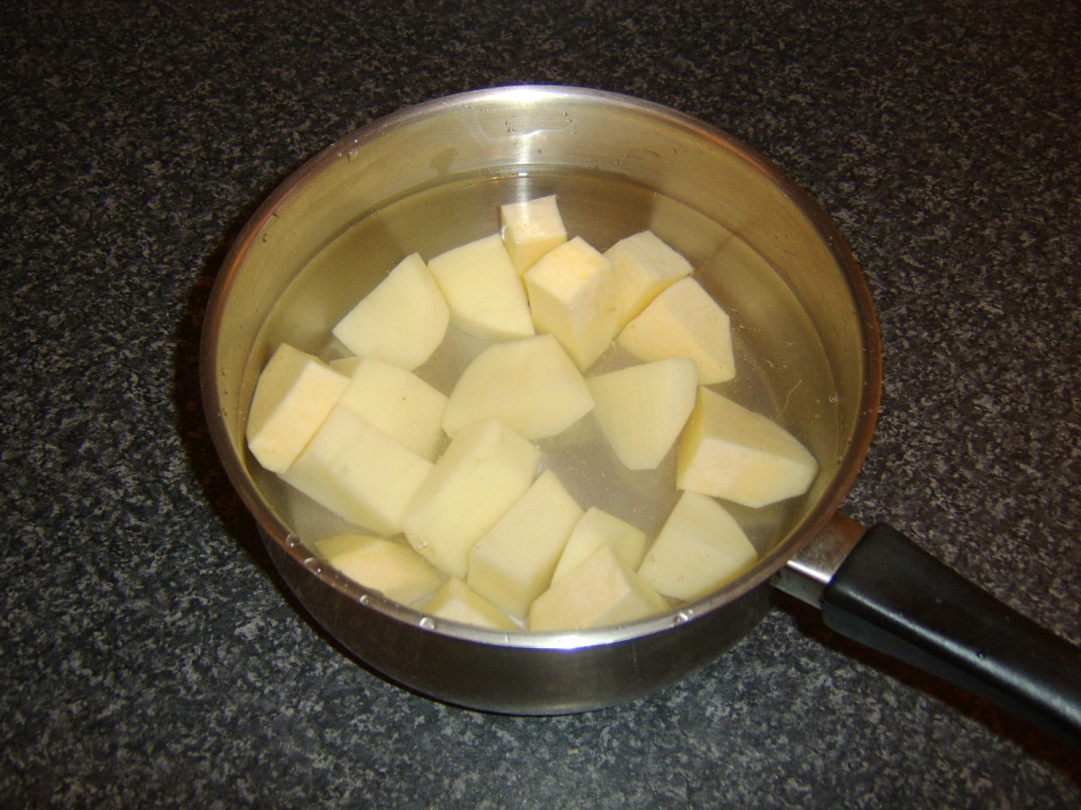 Chopped potato and Swede are boiled