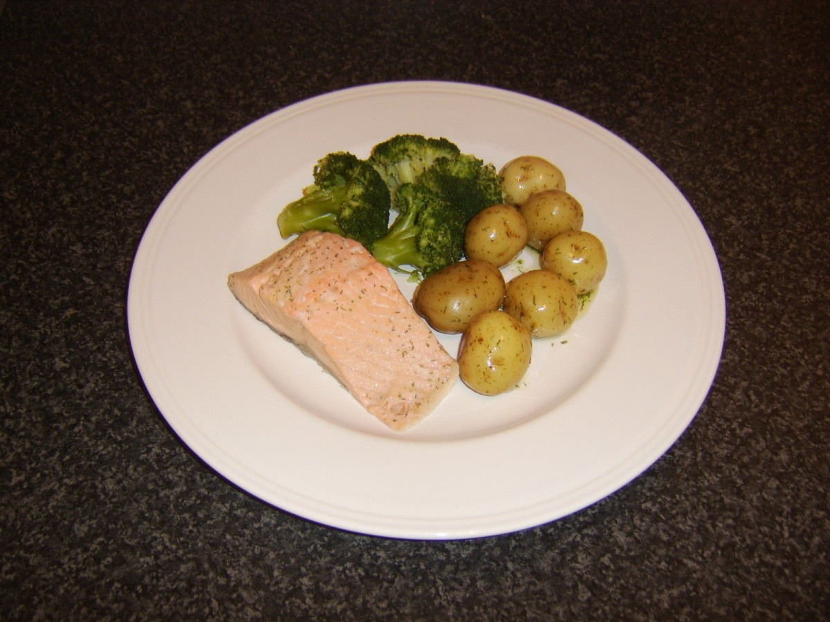 Scottish salmon loin fillet, poached in white wine and served with herb buttered new potatoes and broccoli