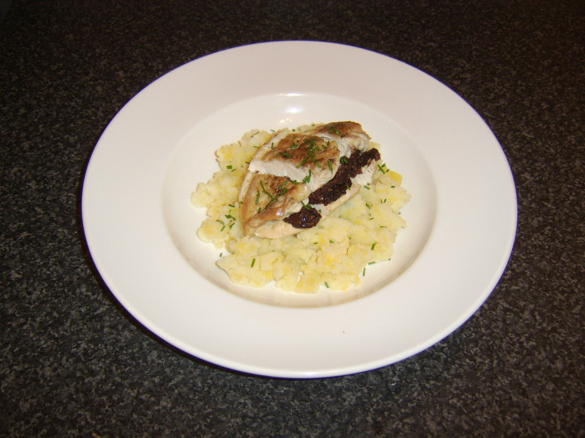 Chicken breast is stuffed with black pudding and baked in the oven, before being served on mashed potato and Swede turnip with chives
